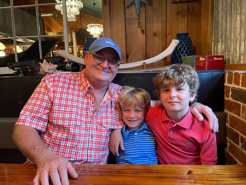 Angler Pat Crawford with Grandsons
